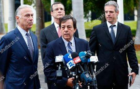 Mickael Behn, Javier Garcia-Bengochea, Bob Martinez, Rodney Margol. Attorney Rodney Margol, center, speaks during a news conference along with attorney Bob Martinez, left, clients Javier Garcia-Bengochea, center rear, and Mickael Behn, right, after filing lawsuits against Carnival Cruise Line, which has been using the clients former properties in Cuba, in Miami. Behn and Garcia-Bengochea, are the heirs of families that owned ports in Havana and Santiago de Cuba now being used to dock cruise ships that began traveling to Cuba in 2016 under President Barack Obama's detente with the island