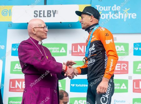 The Roompot-Charles rider Jesper Asselman celebrates with the Bishop of Selby John Thompson (L) winning the first stage of the the Tour de Yorkshire 182,5 km between Doncaster and Selby, in Selby, Britain, 02 May 2019.