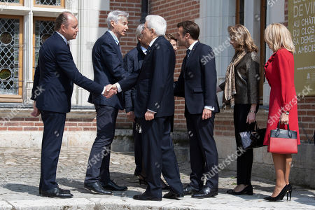 Henri, Francois, Edouard and Marie Saint Bris welcome French President Emmanuel Macron and his wife Brigitte Trogneux with Italian President Sergio Mattarella and his daughter Laura Mattarella at the Chateau du Clos Luce as part of a visit to commemorate the 500th anniversary of the death of Italian renaissance painter and scientist Leonardo da Vinci