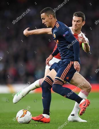 Rodrigo of Valencia and Laurent Koscielny of Arsenal