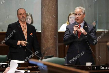 John Stevens, Mike Bell. Sen. John Stevens, R-Huntingdon, right, speaks as Sen. Mike Bell, R-Riceville, left, waits his turn during debate on Stevens' concealed handgun carry permit legislation, in Nashville, Tenn