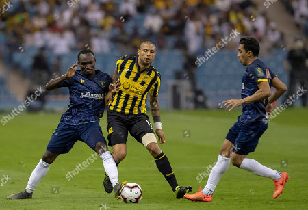 Al-Taawoun player Cedric Amissi (L) in action for the ball with Al-Ittihad player Manuel Marouan Da Costa (R) during the Saudi King's Cup soccer match between Al-Taawoun and Al-Ittihad at King Fahd International Stadium in Riyadh, Saudi Arabia, 02 May 2019.