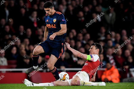 Valencia's Goncalo Guedes (L) in action against Arsenal's Laurent Koscielny (R) during the UEFA Europa League semi final first leg soccer match between Arsenal FC and Valencia CF in London, Britain, 02 May 2019.