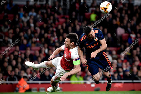 Valencia's Goncalo Guedes (R) in action against Arsenal's Laurent Koscielny (L) during the UEFA Europa League semi final first leg soccer match between Arsenal FC and Valencia CF in London, Britain, 02 May 2019.