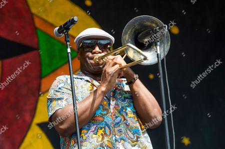 Stock Image of Big Sam of Big Sam's Funky Nation performs at the New Orleans Jazz and Heritage Festival, in New Orleans