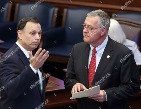 Sen. Tom Lee, R-Brandon, left, confers with Sen. Ben Albritton, R-Wauchula, during session, in Tallahassee, Fla