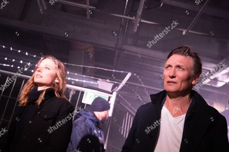 German actress Svenja Jung (L) and actor Oliver Masucci (R) attend the world premiere audio play live performance of the thriller 'AURIS' at the former NSA spy station on top of the Teufelsberg mountain in Berlin, Germany, 30 April 2019. Thriller story AURIS about a forensic phonetician, written by Vincent Kliesch after an idea of Sebastian Fitzek, is available as a book and audio play.