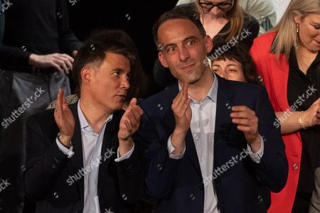 French essayist and founder of the citizen movement Place Publique and candidate for elections to the European Parliament, Raphael Glucksmann (R) applauds near First Secretary General of the Socialist Party (PS) Olivier Faure (L) during a meeting at Bordeaux, France, 02 May 2019. Elections to the European Parliament will take place from 23 to 26 May 2019.