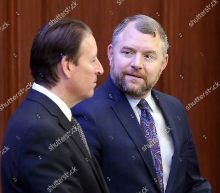 Sen. Rob Bradley, R-Fleming Island, right, confers with Senate president Bill Galvano, R-Bradenton during session, in Tallahassee, Fla