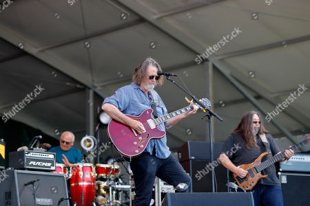 Widespread Panic performs performs at the New Orleans Jazz & Heritage Festival in New Orleans, . Foreground is guitarist John Bell, left is percussionist Domingo Ortiz and right is bassist Dave Schools