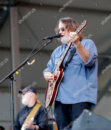 John Bell, lead guitarist for Widespread Panic performs with the band at the New Orleans Jazz & Heritage Festival in New Orleans, . Behind is guitarist Jimmy Herring