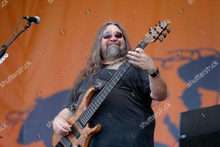 Stock Image of Dave Schools, bassist for Widespread Panic performs with the band at the New Orleans Jazz & Heritage Festival in New Orleans, . Behind is guitarist Jimmy Herring