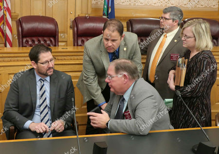 Kansas House Speaker Ron Ryckman Jr., left confers with fellow House members and staffers before an unsuccessful attempt to revive an anti-abortion bill vetoed by Democratic Gov. Laura Kelly, at the Statehouse in Topeka, Kansas. Conferring with Ryckman are, House Majority Leader Dan Hawkins, R-Wichita, center seated, Melinda Gaul, Ryckman's communications director, right, Rep. Kyle Hoffman, R-Coldwater, second from right, and B.J. Harden, Hawkins' chief of staff