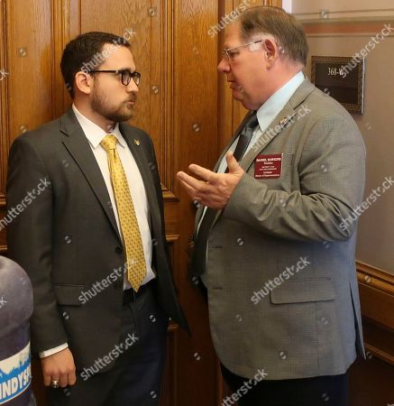 Kansas House Majority Leader Dan Hawkins, right, R-Wichita, confers with Rep. Blake Carpenter, R-Derby, before an unsuccessful attempt to revive an anti-abortion bill vetoed by Democratic Gov. Laura Kelly, at the Statehouse in Topeka, Kansas. Carpenter led the effort to save the bill, which would require abortion providers to tell patients that a medication abortion can be reversed once it has been started