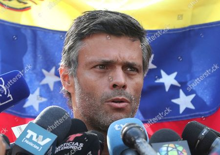 Venezuelan opposition leader Leopoldo Lopez speaks during a press conference at the gate of the Spanish ambassador's residence in Caracas, Venezuela, . López said he expects that the country's military will step up to overthrow President Nicolas Maduro despite setbacks