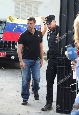 Venezuelan opposition leader Leopoldo Lopez walks to gate of the Spanish ambassador's residence in Caracas to speak with the press, in Venezuela, . López said he expects that the country's military will step up to overthrow President Nicolas Maduro despite setbacks