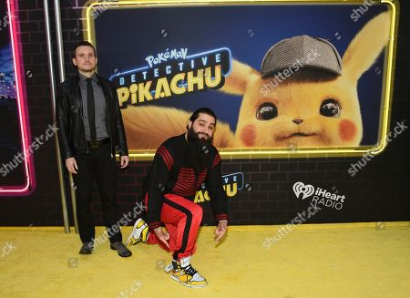 """Derek Connolly, Jordan Vogt-Roberts. Writers Derek Connolly, left, Jordan Vogt-Roberts attend the premiere of """"Pokemon Detective Pikachu"""" at Military Island in Times Square, in New York"""