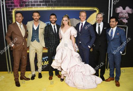 """Ken Watanabe, Ryan Reynolds, Justice Smith, Kathryn Newton, Chris Geere, Rob Letterman, Omar Chaparro. Actors Ken Watanabe, left, Ryan Reynolds, Justice Smith, Kathryn Newton, Chris Geere, director Rob Letterman and actor Omar Chaparro pose together at the premiere of """"Pokemon Detective Pikachu"""" at Military Island in Times Square, in New York"""