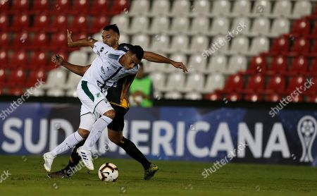 Stock Image of Ramón Martínez, Christian Rivera. Christian Rivera, front, of Colombia's Deportivo Cali fights for the ball with Ramón Martínez of Paraguay's Guarani during a Copa Sudamericana soccer game, in Asuncion, Paraguay
