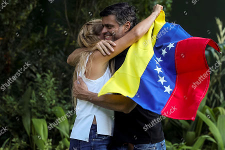 Venezuelan opposition leader Leopoldo Lopez (R) hugs his wife Lilian Tintori (L) while speaking to the media in Caracas, Venezuela, 02 May 2019. Lopez said today that ruling Nicolas Maduro had lost the confidence of his military command.