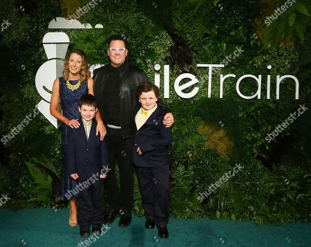 Celebrity chef and Gala honoree Graham Elliot is pictured with his family at Smile Train's 20th Anniversary Gala, in New York. Smile Train empowers local medical professionals to provide cleft surgery and comprehensive cleft care to children globally