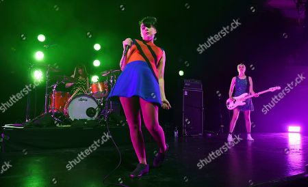 Kathleen Hanna, center, Tobi Vail, left, and Kathi Wilcox of the punk rock band Bikini Kill perform at the Hollywood Palladium, in Los Angeles. The 2019 tour marks the band's first live shows in two decades