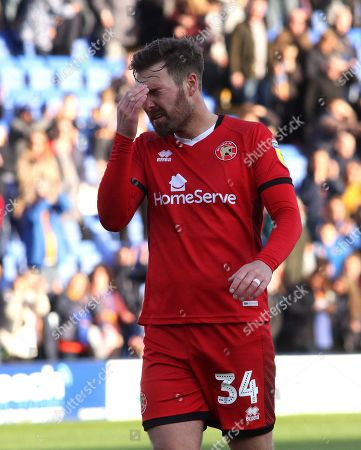 Scott Laird of Walsall is distraught after Walsall were relegated to League Two in  the League One  match at Montgomery Waters Meadow Shrewsbury 04052019