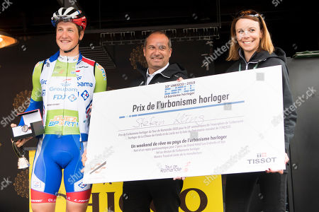 Stefan Kueng (L) from Switzerland of team Groupama-FDJ receives the 'Prix de l?urbanisme horloger' from Tour de Romandie director Richard Chassot (C) and Tour de Romandie secretary general Emilie Lambelet, (R) before before the third stage of the 73th Tour de Romandie UCI ProTour cycling race, over 160 km in Romont, Switzerland, 03 May 2019.