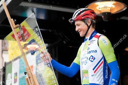 Stefan Kueng from Switzerland of team Groupama-FDJ signs before the third stage of the 73th Tour de Romandie UCI ProTour cycling race, over 160 km in Romont, Switzerland, 03 May 2019.