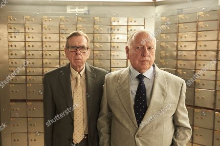 Timothy Spall as Terry Perkins and Kenneth Cranham as Brian Reader.