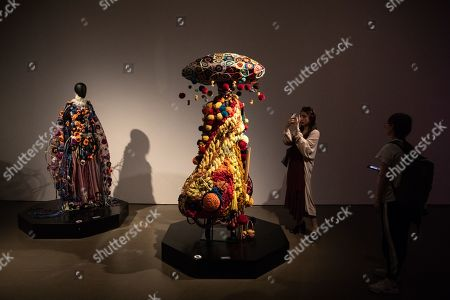 Visitors take photos of mannequins in costumes during the 'Tim Yip: Mirror' exhibition at the Today Art Museum in Beijing, China, 03 May 2019. Tim Yip is an artist, costume designer, and art director for stage and film. The exhibition 'Tim Yip: Mirror' shows various expression formats of art using photography, video, installation and sculpture. The exhibition runs from 13 April to 21 July 2019.