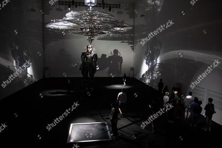 Visitor look at an artwork installation during the 'Tim Yip: Mirror' exhibition at the Today Art Museum in Beijing, China, 03 May 2019. Tim Yip is an artist, costume designer, and art director for stage and film. The exhibition 'Tim Yip: Mirror' shows various expression formats of art using photography, video, installation and sculpture. The exhibition runs from 13 April to 21 July 2019.