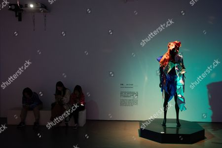 Visitor next to a mannequin in a costume during the 'Tim Yip: Mirror' exhibition at the Today Art Museum in Beijing, China, 03 May 2019. Tim Yip is an artist, costume designer, and art director for stage and film. The exhibition 'Tim Yip: Mirror' shows various expression formats of art using photography, video, installation and sculpture. The exhibition runs from 13 April to 21 July 2019.