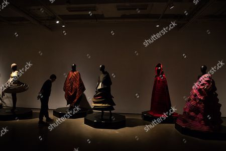 A visitor looks at mannequins in costumes during the 'Tim Yip: Mirror' exhibition at the Today Art Museum in Beijing, China, 03 May 2019. Tim Yip is an artist, costume designer, and art director for stage and film. The exhibition 'Tim Yip: Mirror' shows various expression formats of art using photography, video, installation and sculpture. The exhibition runs from 13 April to 21 July 2019.