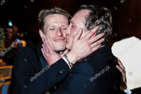 Oliver Masucci (R) kisses German actor Alexander Scheer, winner of the 'LOLA' for best male leading role, during the after-show party of the 69th German Film Awards 'LOLA' in Berlin, Germany, 03 May 2019. The most highly endowed cultural award in Germany is presented in 18 categories by the Deutsche Filmakademie (German film academy).