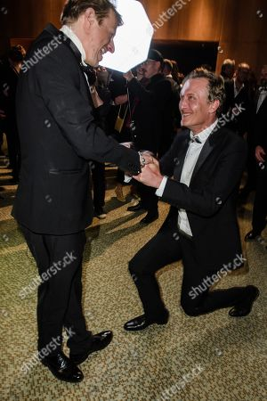Oliver Masucci (R) kneels down in front of German actor Alexander Scheer, winner of the 'LOLA' for best male leading role, during the after-show party of the 69th German Film Awards 'LOLA' in Berlin, Germany, 03 May 2019. The most highly endowed cultural award in Germany is presented in 18 categories by the Deutsche Filmakademie (German film academy).