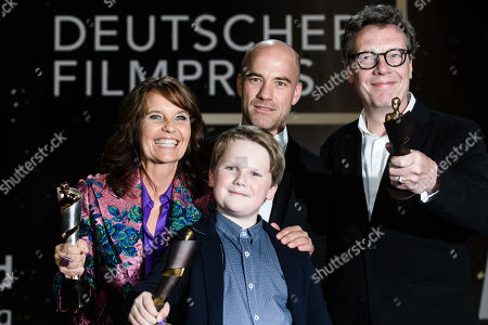 Stock Photo of Caroline Link (L) and Julius Weckauf (2-L) and other members of the cast pose with their awards in the 69th German Film Awards 'LOLA' in Berlin, Germany, 03 May 2019. The most highly endowed cultural award in Germany is presented in 18 categories by the Deutsche Filmakademie (German film academy).