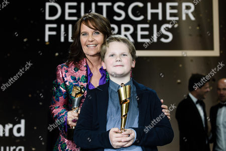 Stock Image of Caroline Link (L) and Julius Weckauf pose with their awards in the 69th German Film Awards 'LOLA' in Berlin, Germany, 03 May 2019. The most highly endowed cultural award in Germany is presented in 18 categories by the Deutsche Filmakademie (German film academy).