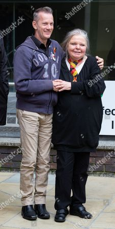 Stock Picture of Su Gorman, whose husband, Steve Dymond, died 3 years ago just before Christmas is comforted by her friend, Mark Ward at the Infected Blood Inquiry at Fleetbank House, London.