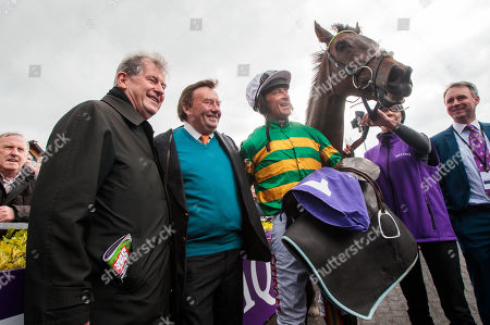 The BETDAQ Punchestown Champion Hurdle. Owner JP McManus, Trainer Nicky Henderson and jockey Davy Russell and with Buveur D'Air after winning