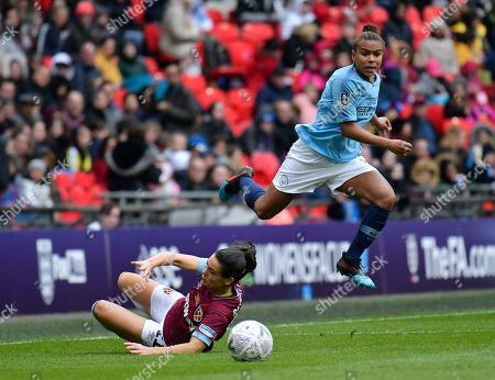 Claire Rafferty of West Ham Women makes a sliding tackle on Nikita Parris of Manchester City Women