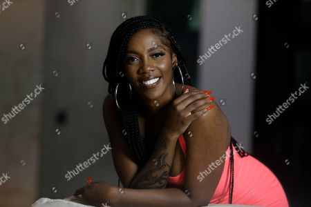 """On, Nigerian singer-songwriter Tiwa Savage, poses for a photo, prior to an interview with The Associated Press in Lagos, Nigeria. Savage says there's a """"revolution going on"""" in African music and she is """"very humbled and excited"""" to take her music to a worldwide audience. """"It's a beautiful journey, it's history in the making,"""" Savage says of her newly announced recording deal. She is one of the world's leading Afrobeats artists and the first African artist to sign a global deal with Universal Music Group"""
