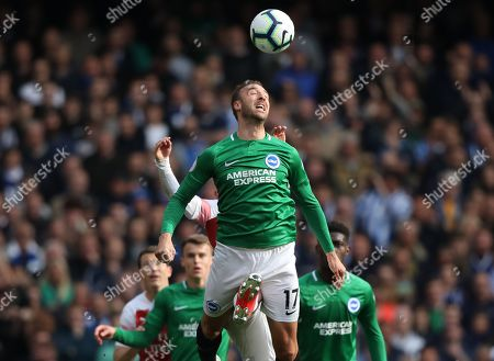 Stock Image of Glenn Murphy (B&HA) has a boot appear between his legs at the Arsenal v Brighton and Hove Albion English Premier League football match at The Emirates Stadium, London, UK on May 5, 2019. **Editorial use only, license required for commercial use. No use in betting, games or a single club/league/player publications**