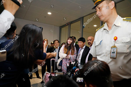 Doan Thi Huong (C) answers questions from media after she arrives at Noi Bai international airport in Hanoi, Vietnam 03 May 2019. Huong was released from prison on 03 May 2019 after accepting a deal with Malaysian prosecutors. She was accused of assassinating North Korean leader Kim Jong Un's half-brother, Kim Jong Nam.