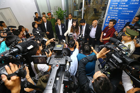 Doan Thi Huong (C) answers questions from media after she arrives at Noi Bai international airport in Hanoi, Vietnam, 03 May 2019. Huong was released from prison on 03 May 2019 after accepting a deal with Malaysian prosecutors. She was accused of assassinating North Korean leader Kim Jong Un's half-brother, Kim Jong Nam.
