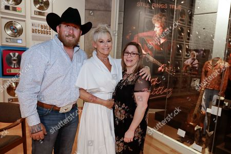 Stock Photo of Lorrie Morgan, Jesse Keith Whitley, Morgan Whitley. Lorrie Morgan poses with her son, Jesse Keith Whitley, left, and adopted daughter Morgan Whitley, right, at the Keith Whitley exhibit at the Country Music Hall of Fame and Museum in Nashville, Tenn. Keith Whitley seemed destined for greatness, but his life was cut tragically short at the age of 33 because of his alcohol addiction. Morgan, his widow, said she hopes people see the struggles he endured to live his dream. Jesse Keith Whitley is the son of Lorrie Morgan and Keith Whitley, and Morgan Whitley is the daughter of Keith Whitley, adopted by Lorrie Morgan