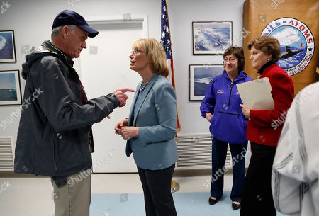 Richard V. Spencer, Susan Collins, Jeanne Shaheen, Maggie Hassan. Secretary of the Navy Richard V. Spencer, left, speaks with Sen. Maggie Hassan, D-NH, after a news conference at the Portsmouth Naval Shipyard, Friday, May, 3, 2019, in Kittery, Maine. Members of Maine and New Hampshire's congressional delegations, including Sen. Susan Collins, R-Maine, and Sen. Jeanne Shaheen, D-NH, at right, have been working to prevent shipyard construction projects from being cut to fund President Donald Trump's wall at the southern border