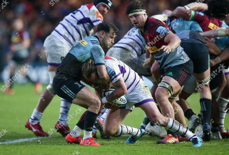 Danny Care of Harlequins gets Sam Harrison of Leicester in a headlock