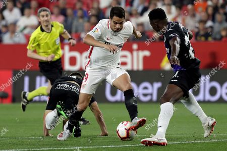 Sevilla FC's Wissam Ben Yedder (C) in action against CD Leganes' Unai Bustinza (L) and Kenneth Josiah Omeruo (R) during a Spanish LaLiga soccer match between Sevilla FC and Leganes at Sanchez Pizjuan stadium in Sevilla, southern Spain, 03 May 2019.