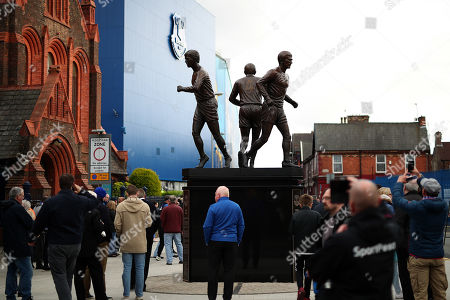 Stock Image of The Holy Trinity statue of former Everton players Howard Kendall, Colin Harvey and Alan Ball is displayed outside the stadium